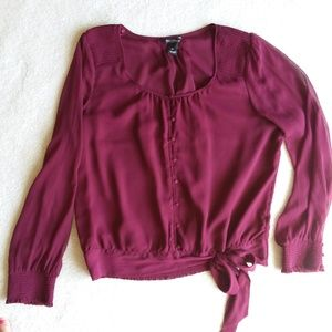 Blouse with button and tie at the hip details